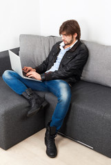 fashion man hipster laptop sitting sofa