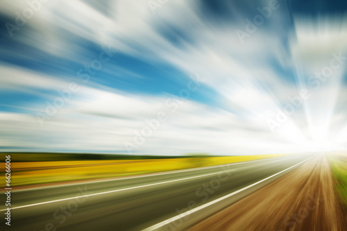 canvas print picture Road through the yellow sunflower field