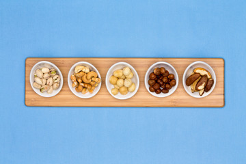 Taster dishes of assorted nuts