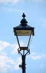 Vintage street light against a blue sky