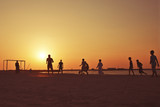 Football at  beach in Dubai during sunset.
