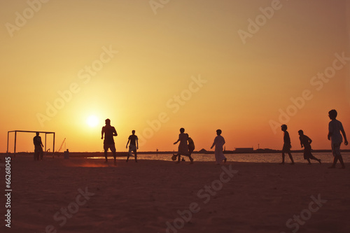 Football at  beach in Dubai during sunset. - 66268045