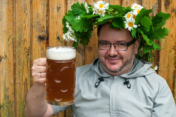 Traditional latvian events Ligo. The man with beer