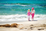 Fototapety Two little sisters having fun on a beach