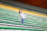 Cute girl on a stadium