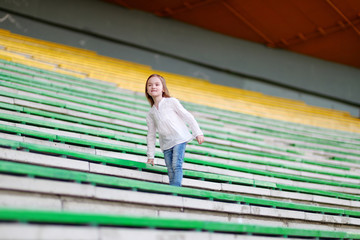 Cute girl on a stadium