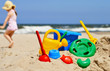 Plastic children toys on the sand beach - 66269013