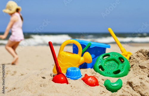 canvas print picture Plastic children toys on the sand beach