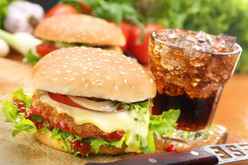 Homemade hamburger with fresh vegetables and cheese on wooden cu