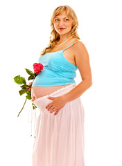 Pregnant woman with flower.