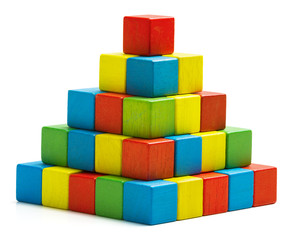 toy blocks pyramid, multicolor wooden bricks stack over white
