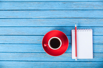 Cup of coffee and notebook.