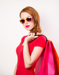 Redhead girl with shopping bags on white background