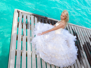 The bride on a wooden platform over the sea..