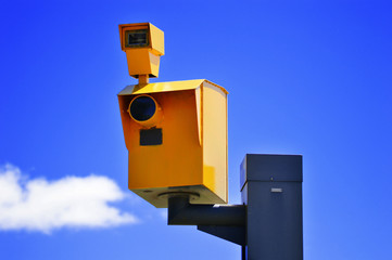 Traffic speed camera over the blue sky