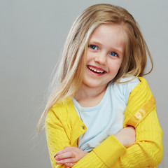 Portrait of fashion girl with long blond hair.