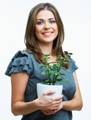Smiling woman hold houseplant. Isolated on white background.