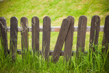 village decorative fence against green lawn background