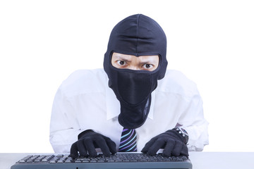 Businessman wearing mask stealing information