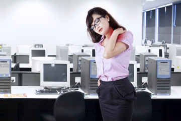Businesswoman having neck pain in office