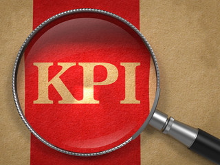 KPI Magnifying Glass on Old Paper.