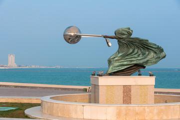 A veiled figure with the globe in a harness, Katara Doha, Qatar