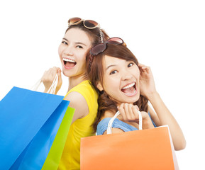 happy young sisters with shopping bags