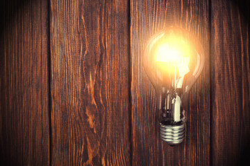 bulb on the brown wooden background