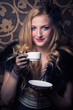 beautiful retro woman drinking coffee