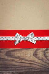 vintage background with wood, old paper and red and white polka