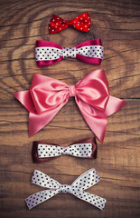colorful bows on wooden background