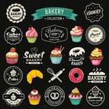Collection of vintage bakery badges and labels on chalkboard.