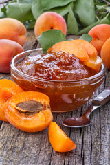 Healthy domestic apricot jam on old rustic table
