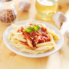 italian dish with penne pasta and tomato sauce