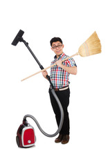 Man with vacuum cleaner and broom on white