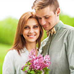 Young couple in love outdoor. They are smiling