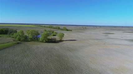Rural landscape with fields, river, and blue sky  .Aerial