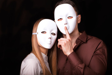 Fashion Happy Couple in Love holding with mask face.