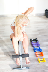 Fitness with young, blond woman