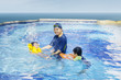 Happy family swimming on the pool 1