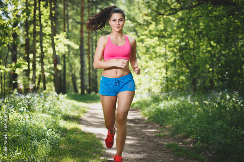 Female Runner Jogging during Outdoor training - 66281805