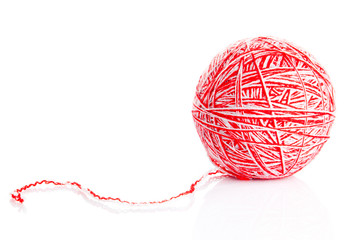 Red wool yarn ball isolated on white background