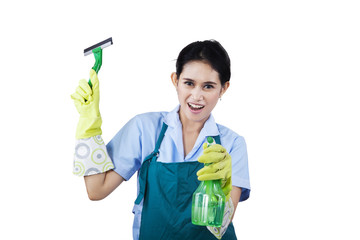 Hotel maid with cleaning tools