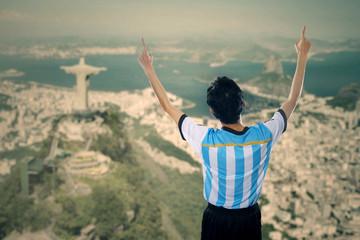 Joyful soccer player celebrate winning