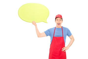 Man in apron holding a blank yellow speech bubble