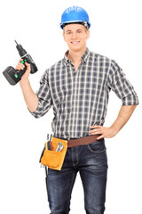 Male carpenter with helmet holding a drill