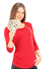 Beautiful young woman holding money