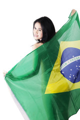 Sexy model holding brazilian flag