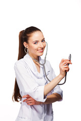 Smiling friendly doctor woman with stethoscope. Isolated over