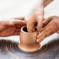 Female Potter creating a bowl on a Potters wheel